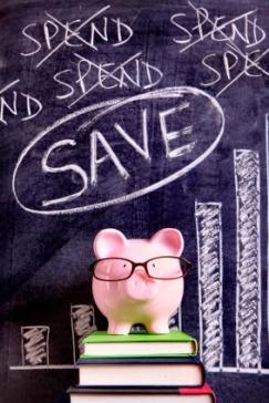 Piggy bank in front of blackboard