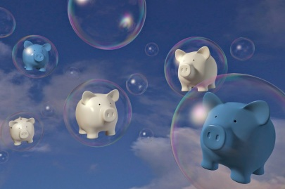 piggy banks in bubbles with a sky background