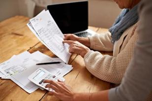 people reviewing tax forms
