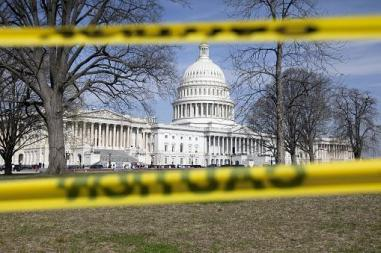 Image of the capital in the background yellow caution tape in foreground
