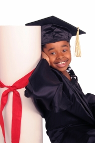 Child with graduation cap and gown