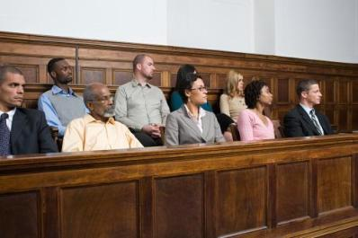 group of people sitting in jury box
