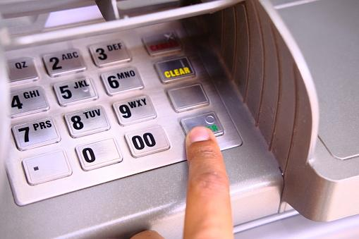 Close up of ATM key pad