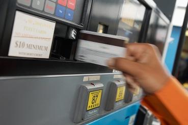 Hand Swiping Card at Gas Pump