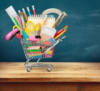 mini shopping cart with school supplies inside