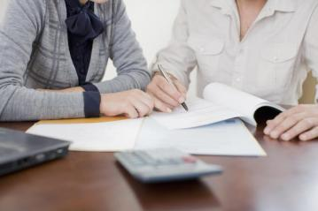 Two women reviewing loan documents