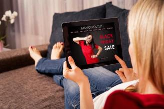 woman shopping black friday sale on tablet