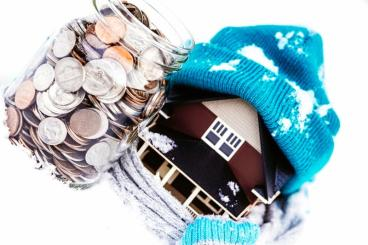 Image of house with stocking cap and money jar