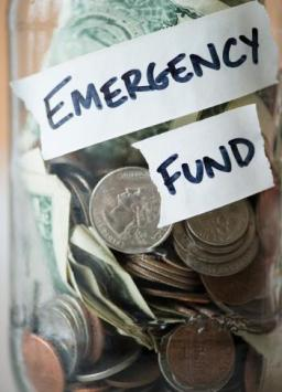 jar with money labeled emergency fund