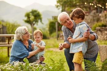 grandparents with two young children