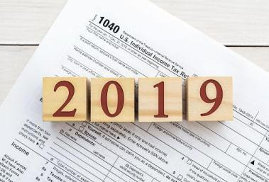 blocks with 2019 on them topping a tax form