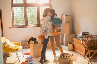 Mother and daughter hugging during a move-in