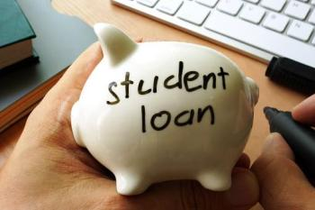Piggy bank with the words student loan written on it
