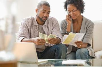 couple looking at bills