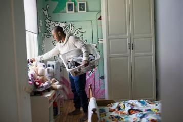 man cleaning up child's room