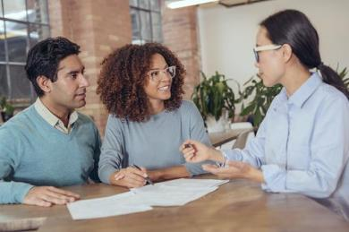 three people going over paperwork