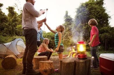 family around a campfire