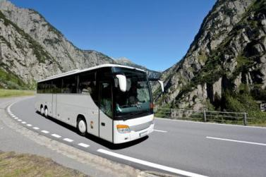 bus on a highway through mountains