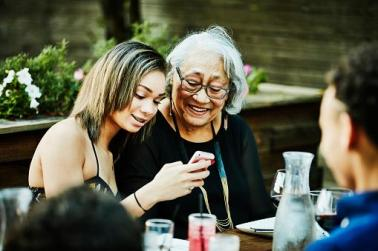 elderly woman with adult grandchildren