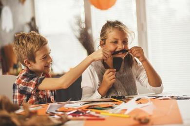 two children making halloween crafts