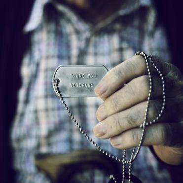 veteran holding dog tags