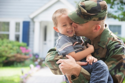 soldier kissing toddler