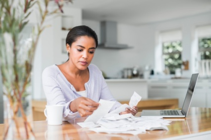 woman going through receipts and bills