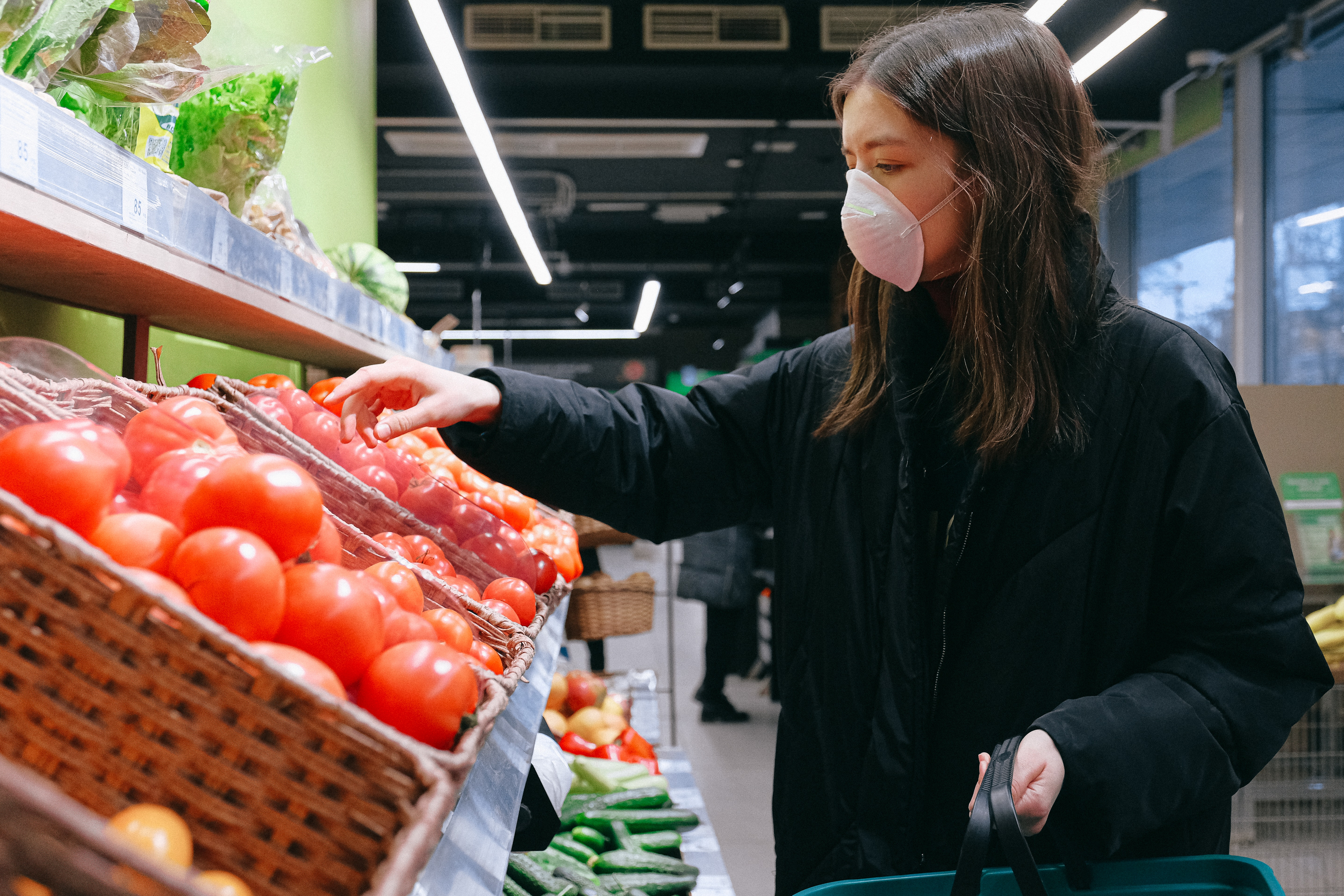 Woman in mask shopping for produce