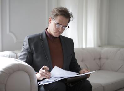 man reviewing papers