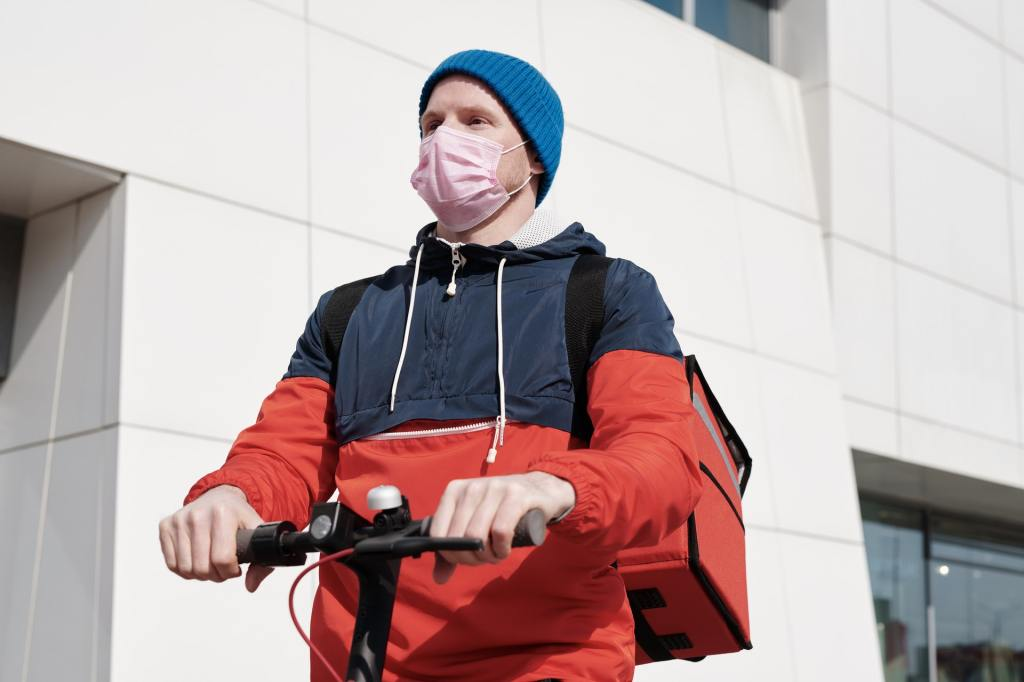 Man on scooter with mask