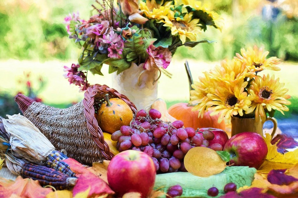 Colorful picture of a cornucopia, Indian Corn, Apples and a vase of Flowers.